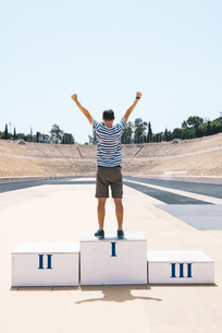 Greece, Athens, man on the podium celebrating in the Panatheの写真素材 [FYI04343116]