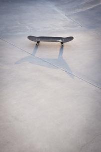 Belgium, Mechelen, Skateboard lying on ground in public skatの写真素材 [FYI04343579]