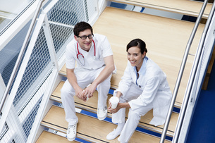 Germany, Bavaria, Diessen am Ammersee, Two young doctors sitの写真素材 [FYI04343582]