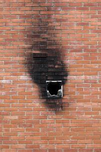 Spain, Burnt window in brick wallの写真素材 [FYI04343730]