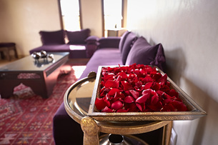 Morocco, Fes, tray of red rose petals in a suite of Hotel Riの写真素材 [FYI04343825]