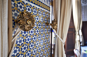 Morocco, Fes, Hotel Riad Fes, tied curtain and wall mosaicの写真素材 [FYI04343829]