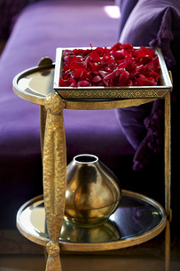 Morocco, Fes, tray of red rose petals in a suite of Hotel Riの写真素材 [FYI04343839]