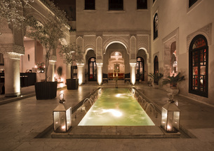 Morocco, Fes, Hotel Riad Fes, courtyard with lightened poolの写真素材 [FYI04343849]