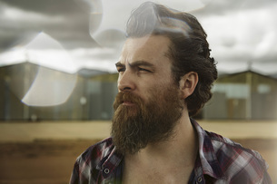Serious man with full beard in abandoned landscapeの写真素材 [FYI04345971]