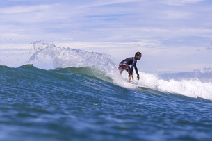 Indonesia, Lombok, Surfer on a waveの写真素材 [FYI04346123]
