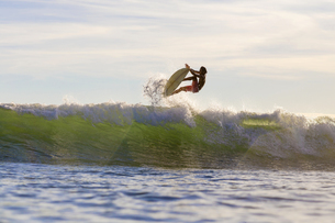 Indonesia, Lombok, Surfer on a waveの写真素材 [FYI04346125]