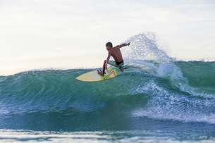 Indonesia, Lombok, Surfer on a waveの写真素材 [FYI04346126]