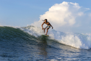 Indonesia, Lombok, Surfer on a waveの写真素材 [FYI04346127]