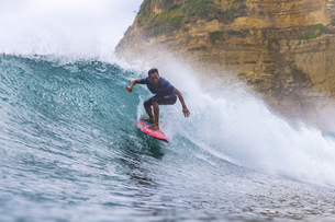 Indonesia, Lombok, Surfer on a waveの写真素材 [FYI04346132]