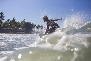 Indonesia, Bali, surfer on waveの写真素材 [FYI04346135]