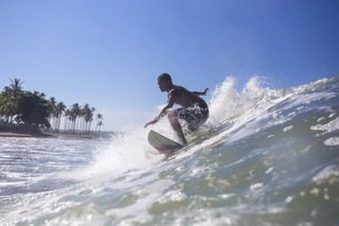 Indonesia, Bali, surfer on waveの写真素材 [FYI04346136]