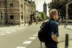 Netherlands, Venlo, businessman standing on a streetの写真素材 [FYI04347771]