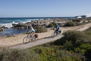 Spain, Formentera, Mature man and mid adult woman riding bicの写真素材 [FYI04348327]