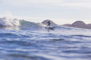 Indonesia, Lombok, Surfer on a waveの写真素材 [FYI04349996]