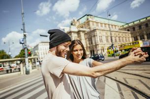 Austria, Vienna, happy young couple dancing Viennese waltz iの写真素材 [FYI04350268]