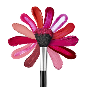 Lipstick and nail polish strokes forming with powder brush aの写真素材 [FYI04351722]