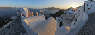 Greece, View of Oia village with cobbled path, roof  and belの写真素材 [FYI04355993]