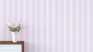 Sideboard with flower vase in front of  striped pink wallpapのイラスト素材 [FYI04357615]