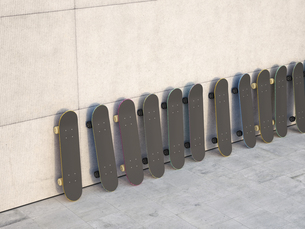Row of skateboards leaning on concrete wall, 3D Renderingのイラスト素材 [FYI04357861]