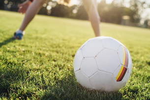 Football with German flag sign on soccer fieldの写真素材 [FYI04361855]