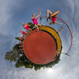 Female high jumper, little planet view, multiple imageの写真素材 [FYI04363124]