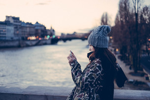 Side View Of Young Woman Photographing By Seine Riverの写真素材 [FYI04370226]