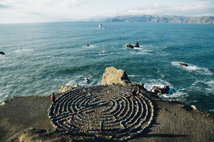 High Angle View Of People Taking Spiritual Journey Through Meditation Labyrinth At Coastの写真素材 [FYI04370648]