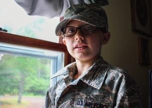 Portrait Of Boy Wearing Military Uniformの写真素材 [FYI04372857]