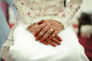 Close-up Of Bride Sitting On Chair During Weddingの写真素材 [FYI04378171]