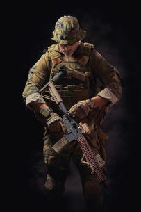 Mature Man In Military Uniform Against Black Backgroundの写真素材 [FYI04389760]