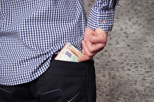 Midsection Of Man Removing Money From Back Pocketの写真素材 [FYI04390242]