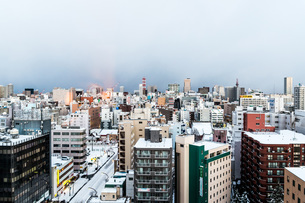 High Angle View Of Urban Skyline Against Cloudy Skyの写真素材 [FYI04396780]