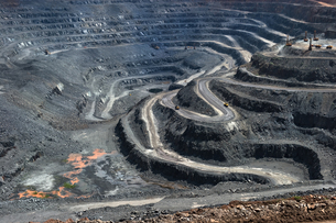High Angle View Of Winding Roads At Open-pit Mineの写真素材 [FYI04397400]