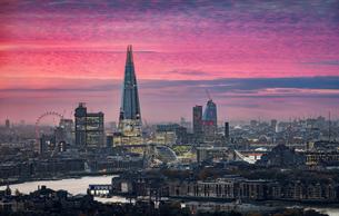 Illuminated Cityscape Against Sky During Sunsetの写真素材 [FYI04405173]