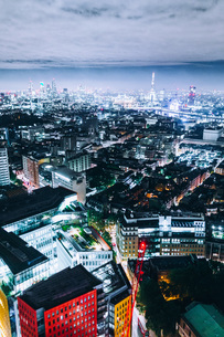Aerial View Of Illuminated Cityscape Against Cloudy Sky At Duskの写真素材 [FYI04405227]