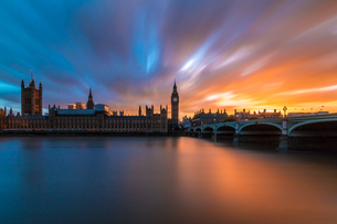 Bridge Over River By Big Ben Against Cloudy Sky During Sunsetの写真素材 [FYI04407120]