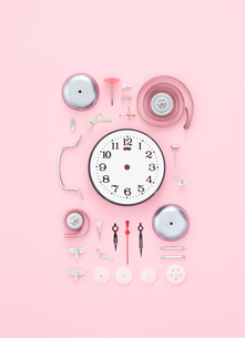 Close-up Of Clock Against Colored Backgroundの写真素材 [FYI04414423]