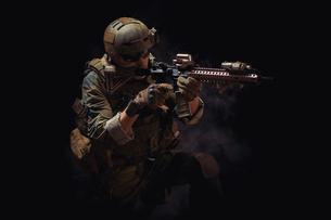 Mature Man In Military Uniform Against Black Backgroundの写真素材 [FYI04415945]