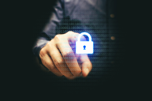 Digital Composite Image Of Man Using Security Lock Against Black Backgroundの写真素材 [FYI04416287]