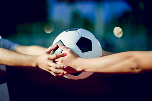 Cropped Hands Of Women Holding Soccer Ballの写真素材 [FYI04419969]