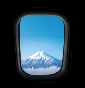 Snowcapped Mountain Seen Through Airplane Windowの写真素材 [FYI04424889]