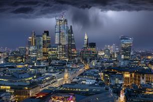 Illuminated Modern Buildings Against Sky At Nightの写真素材 [FYI04434329]