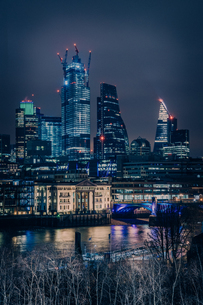 Illuminated Buildings By River Against Sky At Nightの写真素材 [FYI04435014]
