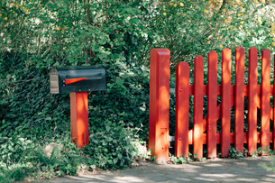 Red Fence Against Plantsの写真素材 [FYI04438981]