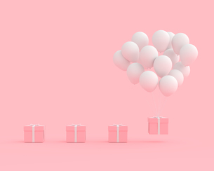 Close-up Of Balloons And Gift Box Against Pink Backgroundの写真素材 [FYI04441425]