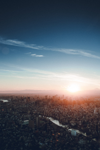 Aerial View Of Cityscape Against Sky During Sunsetの写真素材 [FYI04441928]
