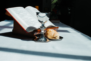 Close-up Of Book With Food And Drink On Table During Sunny Dayの写真素材 [FYI04442781]