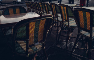 Empty Chairs And Tables Arranged At Sidewalk Cafeの写真素材 [FYI04449601]