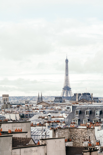 Eiffel Tower And Buildings In City Against Cloudy Skyの写真素材 [FYI04454690]